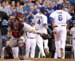 Minnesota Twins catcher Chris Herrmann reaches to tag too late after Kansas City Royals' Eric Hosmer hit a double to score Lorenzo Cain, Alex Gordon (4) and Ben Zobrist during the first inning of a baseball game Tuesday, Sept. 8, 2015, in Kansas City, Mo. (AP Photo/Charlie Riedel)