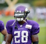 Minnesota Vikings running back Adrian Peterson wears a video camera mounted on the side of his helmet during practice at an NFL football training camp on the campus of Minnesota State University Tuesday, July 28, 2015, in Mankato, Minn. (AP Photo/Charles Rex Arbogast)
