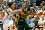 Seattle Storm guard Jewell Loyd (24) drives the ball around Minnesota Lynx guard Anna Cruz (51) during the second half of a WNBA basketball game, Tuesday, Sept. 8, 2015, in Minneapolis. The Lynx won 73-67. (AP Photo/Stacy Bengs)