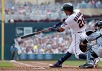 Minnesota Twins' Eddie Rosario hits a grand slam off Chicago White Sox pitcher Jeff Samardzija in the third inning of a baseball game against the Chicago White Sox, Thursday, Sept. 3, 2015, in Minneapolis. (AP Photo/Jim Mone)