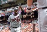 Minnesota Twins' Miguel Sano celebrates his two-run home run against the Baltimore Orioles during the first inning of a baseball game, Sunday, Aug. 23, 2015, in Baltimore. (AP Photo/Nick Wass)