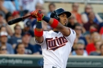 Minnesota Twins' Eddie Rosario follows through on a three-run home run off Seattle Mariners starting pitcher J.A. Happ during the first inning of a baseball game in Minneapolis, Thursday, July 30, 2015. (AP Photo/Ann Heisenfelt)