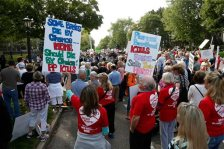 Hundreds of demonstrators gather outside the governor's mansion in St. Paul, Minn., Wednesday, Sept. 9, 2015, in a protest calling for Governor Mark Dayton to defund and investigate Planned Parenthood. St. Paul police diverted traffic to accommodate the large crowd. (AP Photo/Jim Mone)