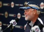 Former Minnesota Twins manager Ron Gardenhire enjoys a laugh during a news conference after Twins general manager Terry Ryan formally announced the firing of the Twins skipper during a baseball news conference, Monday, Sept. 29, 2014, in Minneapolis. (AP Photo/Jim Mone)