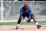 Minnesota Twins' Miguel Sano reaches out to grab a ground ball during a workout at baseball spring training in Fort Myers Fla., Tuesday Feb. 24, 2015. (AP Photo/Tony Gutierrez)