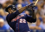 Minnesota Twins designated hitter Miguel Sano watches a solo home run off Kansas City Royals relief pitcher Franklin Morales during the 12th inning of a baseball game at Kauffman Stadium in Kansas City, Mo., Wednesday, Sept. 9, 2015. The Twins defeated the Royals 3-2 in 12 innings. (AP Photo/Orlin Wagner)