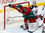 Minnesota Wild's Zach Parise, left, scores against Columbus Blue Jackets goalie Sergei Bobrovsky, right, of Russia in the first period of an NHL hockey game, Thursday, Oct. 22, 2015, in St. Paul, Minn. (AP Photo/Jim Mone)