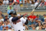 Minnesota Twins designated hitter Miguel Sano follows through on a single off Pittsburgh Pirates starting pitcher Charlie Morton during the first inning of a baseball game in Minneapolis, Tuesday, July 28, 2015. (AP Photo/Ann Heisenfelt)