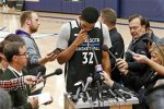 Minnesota Timberwolves' Karrl-Anthony Towns composes himself as he addressed the media Monday, Oct. 26, 2015 in Minneapolis about Timberwolves head coach Flip Saunders who died Sunday at the age of 60. Saunders rose from basketball's minor leagues to become one of the most powerful men in the NBA as coach, team president and part owner of the Timberwolves. (AP Photo/Jim Mone)