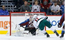 Colorado Avalanche goalie Semyon Varlamov (1) blocks a breakaway shot by Minnesota Wild left wing Zach Parise (11) during the first period of an NHL hockey game Thursday, Oct. 8, 2015, in Denver. (AP Photo/Jack Dempsey)