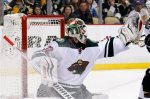 Minnesota Wild goalie Niklas Backstrom (32) gloves a shot by the Pittsburgh Penguins during the second period of an NHL hockey game in Pittsburgh on Tuesday, Jan. 13, 2015. (AP Photo/Gene J. Puskar)