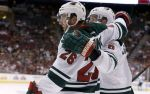 Minnesota Wild's Thomas Vanek (26), of Austria, celebrates his goal against the Arizona Coyotes with Marco Scandella, right, during the first period of an NHL hockey game Thursday, Oct. 15, 2015, in Glendale, Ariz. (AP Photo/Ross D. Franklin)