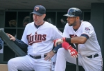 Minnesota Twins manager Paul Molitor, left, chats with Aaron Hicks prior to Hicks' at-bat against the Los Angeles Angels in the eighth inning of a baseball game, Sunday Sept. 20, 2015, in Minneapolis. (AP Photo/Richard Marshall)
