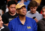 Former Los Angeles Lakers player Kareem Abdul-Jabbar wears a hat bearing the name and jersey number of former Lakers teammate James Worthy as he attends the NBA basketball ball between the Portland Trail Blazers and Los Angeles Lakers in Los Angeles, Tuesday, April 1, 2014. (AP Photo/Danny Moloshok)