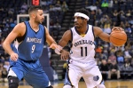 Memphis Grizzlies guard Mike Conley (11) controls the ball against Minnesota Timberwolves guard Ricky Rubio (9) in the first half of an NBA basketball preseason game, Sunday, Oct. 18, 2015, in Memphis, Tenn. (AP Photo/Brandon Dill)