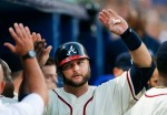 Atlanta Braves' A.J. Pierzynski (15) celebrates in the dugout after scoring on a Eury Perez base hit in the fourth inning of a baseball game against the New York Mets Saturday, June 20, 2015, in Atlanta.  (AP Photo/John Bazemore)