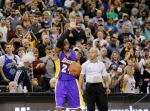 Los Angeles Lakers guard Kobe Bryant (24) holds up the game ball and acknowledges the crowd during the second quarter of an NBA basketball game against the Minnesota Timberwolves after passing Michael Jordan on the NBA all-time scoring list in Minneapolis, Sunday, Dec. 14, 2014. (AP Photo/Ann Heisenfelt)