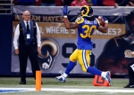 St. Louis Rams running back Todd Gurley scores on a 71-yard run during the second quarter of an NFL football game against the San Francisco 49ers, Sunday, Nov. 1, 2015, in St. Louis. (AP Photo/Billy Hurst)