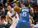 Miami Heat guard Tyler Johnson (8) and Minnesota Timberwolves forward Shabazz Muhammad (15) battle for a rebound during the first half of an NBA basketball game, Tuesday, Nov. 17, 2015, in Miami. (AP Photo/Wilfredo Lee)