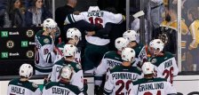 Minnesota Wild left wing Jason Zucker (16) is helped from the ice after an injury in the final seconds of the third period of an NHL hockey game against the Boston Bruins in Boston Thursday, Nov. 19, 2015. (AP Photo/Charles Krupa)