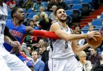 Detroit Pistons' Reggie Jackson, left, of Italy, tries to get the ball away from Minnesota Timberwolves' Ricky Rubio of Spain in the first quarter of an NBA basketball game, Friday, Nov. 20, 2015, in Minneapolis. (AP Photo/Jim Mone)