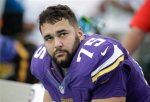Minnesota Vikings tackle Matt Kalil (75) looks up from the sidelines during the second half of an NFL football game against the Miami Dolphins, Sunday, Dec. 21, 2014, in Miami Gardens, Fla. The Dolphins defeated the Vikings 37-35.  (AP Photo/Lynne Sladky)