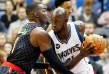 Minnesota Timberwolves' Kevin Garnett, right, drives on Atlanta Hawks' Paul Millsap  in the first quarter of an NBA basketball game, Wednesday, Nov. 25, 2015, in Minneapolis. (AP Photo/Jim Mone)