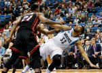 Minnesota Timberwolves' Karl-Anthony Towns, right, is fouled by Miami Heat's Hassan Whiteside after a shot-attempt in the first quarter of an NBA basketball game, Thursday, Nov. 5, 2015, in Minneapolis. (AP Photo/Jim Mone)