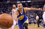 Golden State Warriors guard Stephen Curry (30) chases the ball after knocking it loose from Memphis Grizzlies guard Courtney Lee in the second half of an NBA basketball game, Wednesday, Nov. 11, 2015, in Memphis, Tenn. (AP Photo/Brandon Dill)