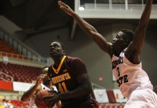 Missouri State guard Loomis Gerring, right, looks to shoot pressured by Minnesota forward Gaston Diedhiou, during the Puerto Rico Tip-Off college basketball tournament in San Juan, Friday, Nov. 20, 2015. (AP Photo/Ricardo Arduengo)