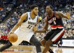 Minnesota Timberwolves' Karl-Anthony Towns, left, drives around Portland Trail Blazers' Al-Farouq Aminu in the first half of an NBA basketball game, Monday, Nov. 2, 2015, in Minneapolis. (AP Photo/Jim Mone)