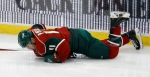Minnesota Wild left wing Zach Parise (11) tries to get up after a hit by Nashville Predators left wing James Neal during the first period of an NHL hockey game in St. Paul, Minn., Thursday, Nov. 5, 2015. Parise later left the game with a lower body injury. The Predators won 3-2. (AP Photo/Ann Heisenfelt)