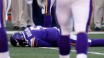 Minnesota Vikings quarterback Teddy Bridgewater lies on the field after a hit during the second half of an NFL football game against the St. Louis Rams, Sunday, Nov. 8, 2015, in Minneapolis. (AP Photo/Ann Heisenfelt)