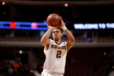Minnesota's Nate Mason (2) shoots a free throw in the second half of an NCAA college basketball game against Rutgers in the first round of the Big Ten Conference tournament, Wednesday, March 11, 2015, in Chicago. Minnesota won 80-68. (AP Photo/Charles Rex Arbogast)