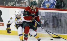 Minnesota Wild left wing Zach Parise, right, and Nashville Predators defenseman Ryan Ellis, left, battle for the puck during the first period of an NHL hockey game in St. Paul, Minn., Thursday, Nov. 5, 2015. (AP Photo/Ann Heisenfelt)