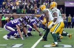 Players get set on the line of scrimmage during the first half of an NFL football game between the Minnesota Vikings and the Green Bay Packers, Sunday, Nov. 23, 2014, in Minneapolis. (AP Photo/Jim Mone)
