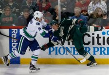 Vancouver Canucks right wing Jake Virtanen (18) hits Minnesota Wild center Mikael Granlund, right, of Finland, during the first period of an NHL hockey game in St. Paul, Minn., Wednesday, Nov. 25, 2015. (AP Photo/Ann Heisenfelt)