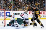 Pittsburgh Penguins' Sidney Crosby (87) can't get to a loose puck behind Minnesota Wild goalie Devan Dubnyk (40) before Jonas Brodin (25) during the second period of an NHL hockey game in Pittsburgh Tuesday, Nov. 17, 2015. (AP Photo/Gene J. Puskar)