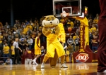 Minnesota mascot Goldy Gopher gestures to the crow during the first half of an NCAA college basketball game against UMKC in Minneapolis, Friday, Nov. 13, 2015. (AP Photo/Ann Heisenfelt)
