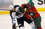 Minnesota Wild defenseman Matt Dumba (24) hits Winnipeg Jets right wing Chris Thorburn (22) during the first period of an NHL hockey game in St. Paul, Minn., Tuesday, Nov. 10, 2015. (AP Photo/Ann Heisenfelt)