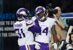 Minnesota Vikings wide receiver Stefon Diggs (14) is congratulated by teammate Jerick McKinnon (31) after scoring on a 36-yard reception for a touchdown during the second half of an NFL football game against the Detroit Lions, Sunday, Oct. 25, 2015, in Detroit. (AP Photo/Duane Burleson)