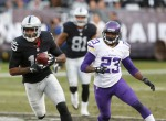 Oakland Raiders wide receiver Michael Crabtree (15) runs in front of Minnesota Vikings defensive back Terence Newman (23) during the second half of an NFL football game in Oakland, Calif., Sunday, Nov. 15, 2015. (AP Photo/Beck Diefenbach)