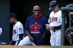 Minnesota Twins right fielder Torii Hunter, center, laughs as he converses with members of the Kansas City Royals dugout during a baseball game Sunday, Oct. 4, 2015, in Minneapolis. The Royals won 6-1. (AP Photo/Bruce Kluckhohn)
