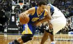 Golden State Warriors' Stephen Curry, left, drives around Minnesota Timberwolves' Andre Miller during the second half of an NBA basketball game, Thursday, Nov. 12, 2015, in Minneapolis. Curry led all scorers with 46 points as the Warriors won 129-116. (AP Photo/Jim Mone)