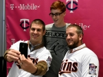 Minnesota Twins' Joe Mauer, left, and Glen Perkins pose for a selfie with a fan during the baseball team's TwinsFest on Friday, Jan. 23, 2015, in Minneapolis. (AP Photo/Hannah Foslien)