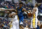 Minnesota Timberwolves guard Andrew Wiggins (22) loses control of the ball defended by Indiana Pacers center Ian Mahinmi, left, and Pacers center Lavoy Allen in the first half of an NBA basketball game, Friday, Nov. 13, 2015, in Indianapolis. (AP Photo/R Brent Smith)