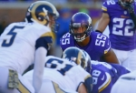 Minnesota Vikings outside linebacker Anthony Barr (55) watches St. Louis Rams quarterback Nick Foles (5)during an NFL football game Sunday, Nov. 8, 2015, in Minneapolis. The Vikings won in overtime, 21-18.  (Jeff Haynes/AP Images for Panini)