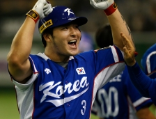 South Korea's Park Byung-ho celebrates at the bench after hitting a three-run home run against Team USA in the fourth inning of their final game at the Premier12 world baseball tournament at Tokyo Dome in Tokyo, Saturday, Nov. 21, 2015. (AP Photo/Toru Takahashi)
