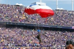 One of several parachutists drops in to TCF Bank Stadium before an NFL football game against the Detroit Lions, Sunday, Sept. 20, 2015, in Minneapolis. (AP Photo/Jim Mone)