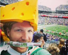 Green Bay Packer fan wearing a cheesehead hat.